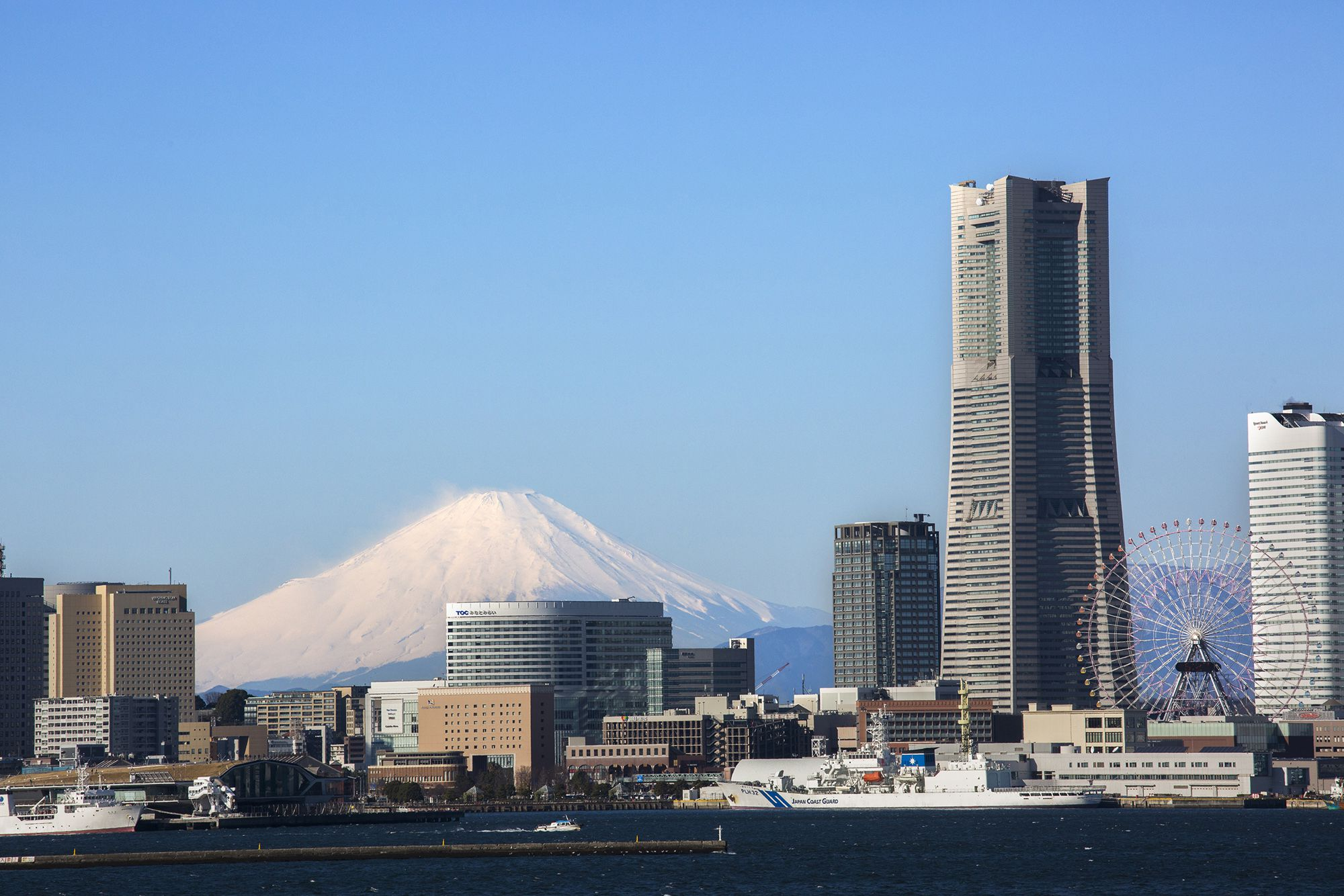 A snow-capped Mount Fuji glimpsed from off the Yokohama coast, from a ferry plying Tokyo Bay.