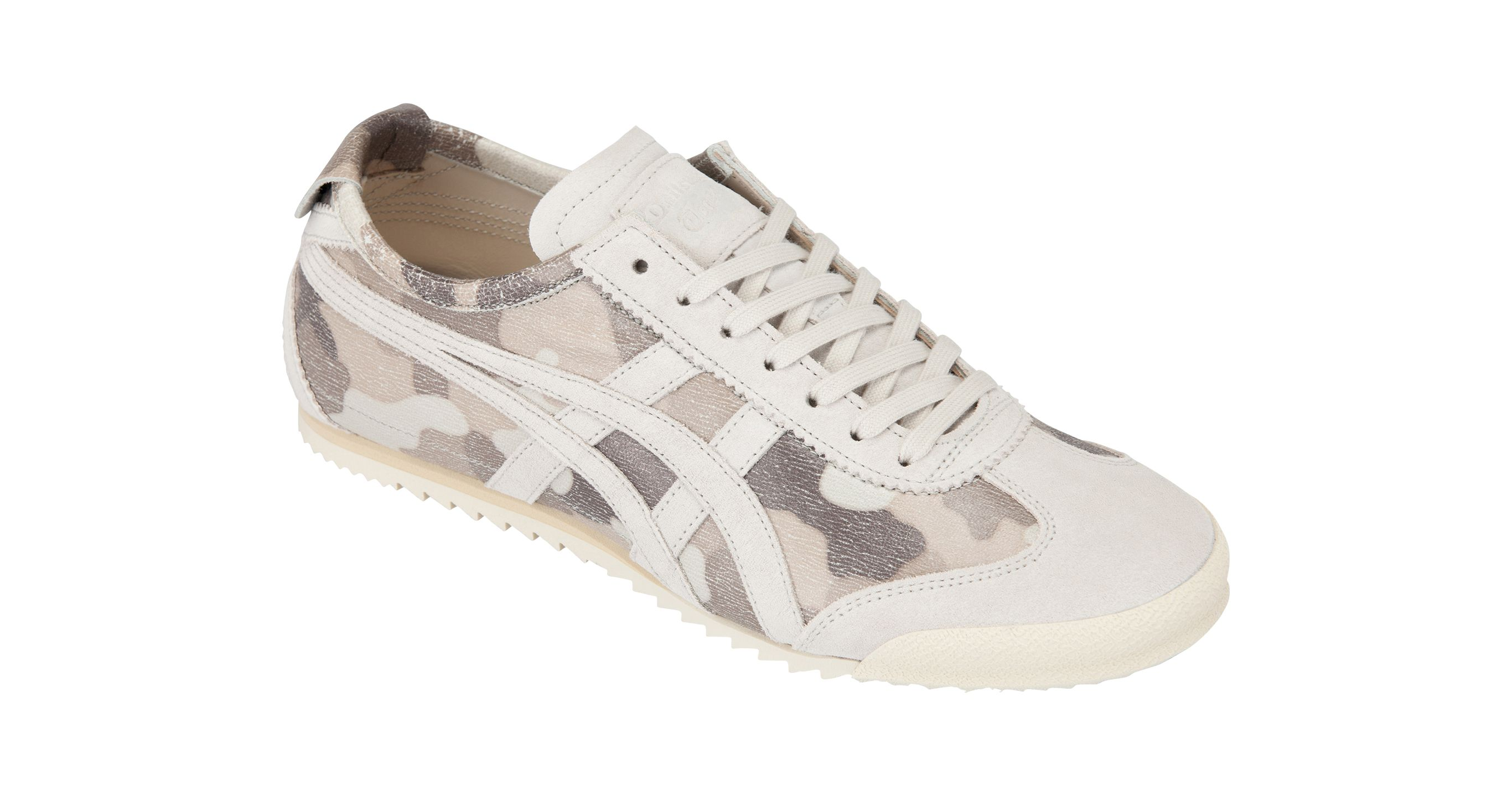 "In August, Onitsuka Tiger will be releasing ""MEXICO SLIP-ON DELUXE"" for their ""NIPPON MADE"" series. The footwear has an elastic strap applied on its instep to provide a comfortable fit. The upper material of the sneaker is leather made in Japan. The sneaker comes in camouflage pattern. WHITE/WHITE 25,920 Yen (Tax Included)"