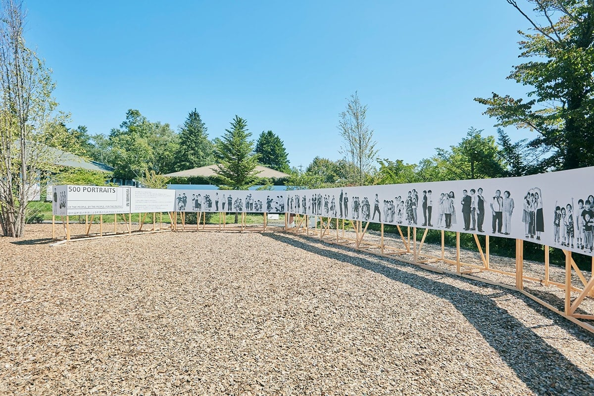 The portraits of more than 500 people of Miyota overwhelms the visitors.