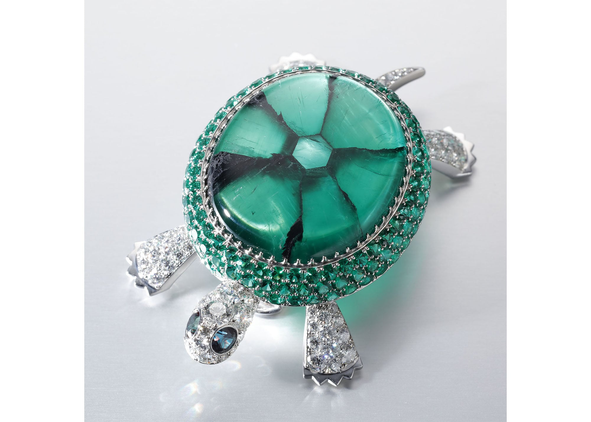 "The ""Turtle"" brooch is designed using the unique crystal structure of the Trapiche Emerald. It is extremely rare to find a Trapiche Emerald with magnificent pattern, that clearly appears like this brooch. Brooch, Pt950, Trapiche Emerald, Emerald Diamond, Alexandrite (Not for Sale)"