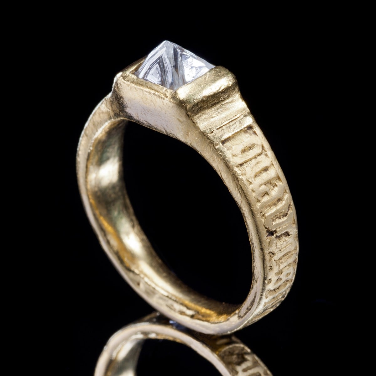 "The Uncut Diamond Ring is the revival of a style seen during the 15th century. A poesy, ""When we are apart, think of me"" is engraved on the hoop of the ring in Norman French. ""Renaissance"