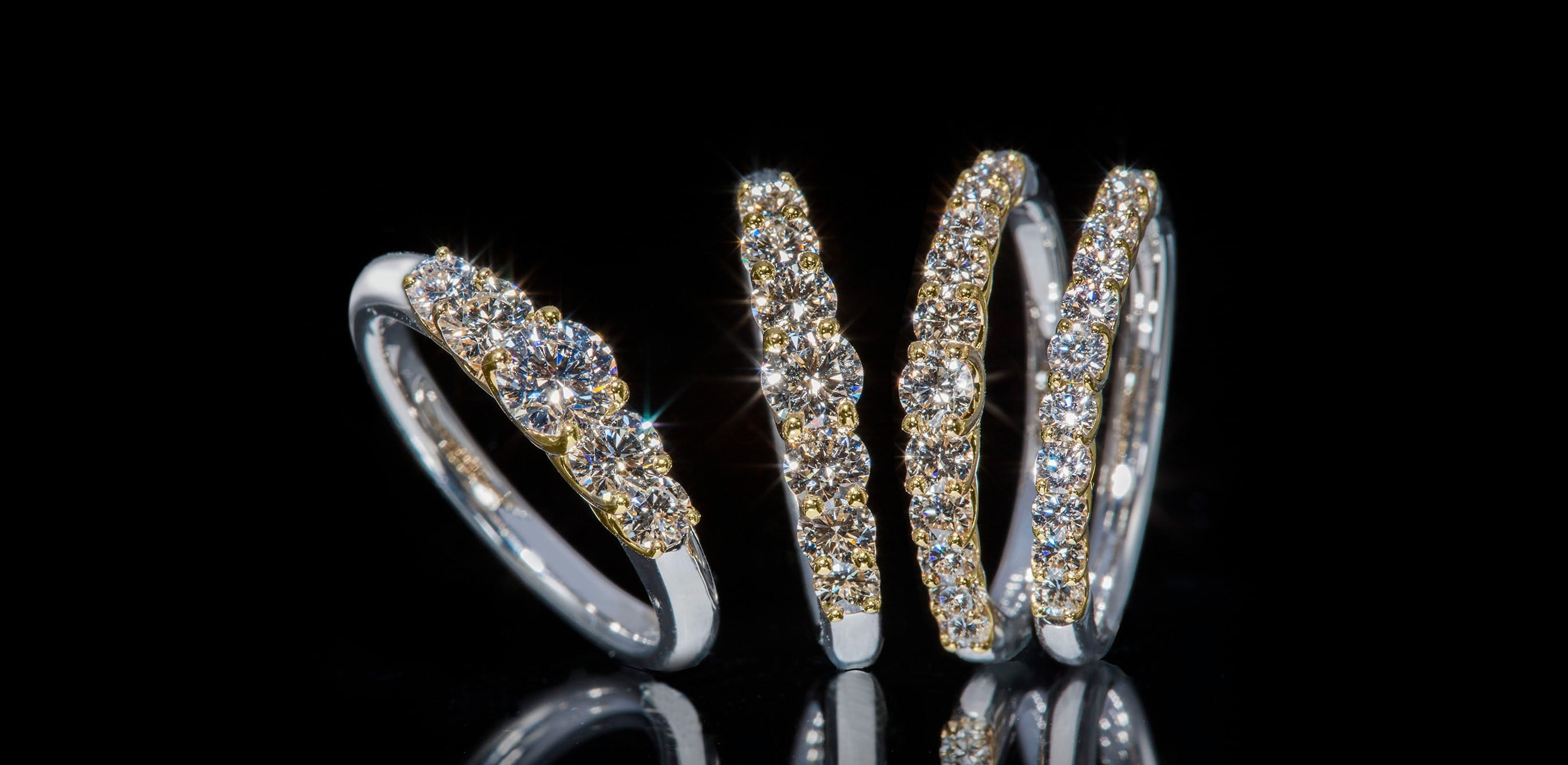 """The diamonds on the bundling are placed to float on the Platinum and K18 Yellow Gold. The clear and transparent sparkle brilliantly shines in a row. """"Air Setting Ring"""". Price from Right: 385,000 Yen, 550,000 Yen, 825,000 Yen, 1,430,000 Yen (Tax Included)"""