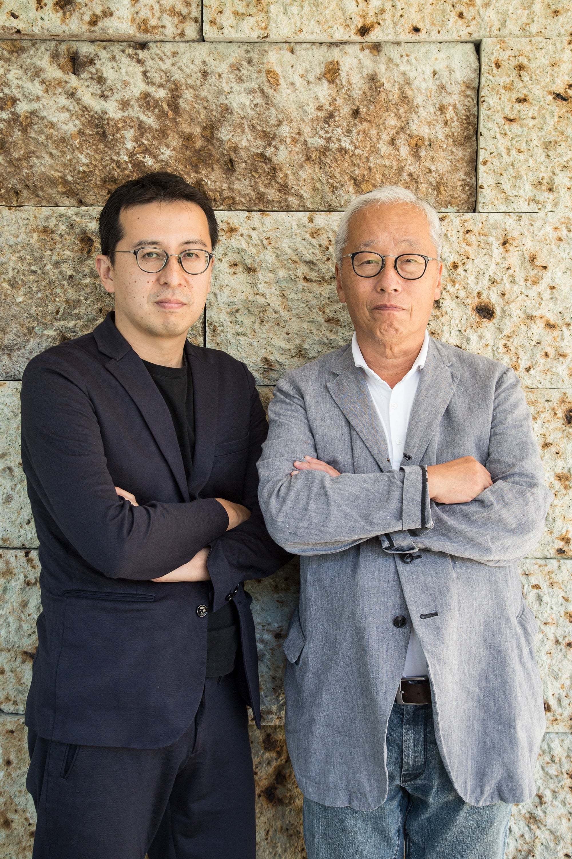 Hiroshi Sugimoto (Right) and Tomoyuki Sakakida (Left). The wall stone behind the two is the Oya Stone from Enoura Observatory.