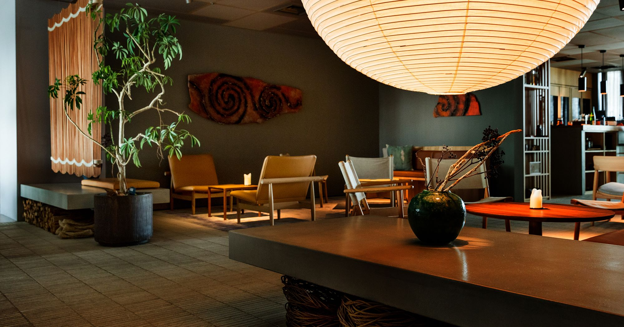The relaxing and cosy atmosphere flows through the lounge area with a bar counter and sofa, besides the dining area.