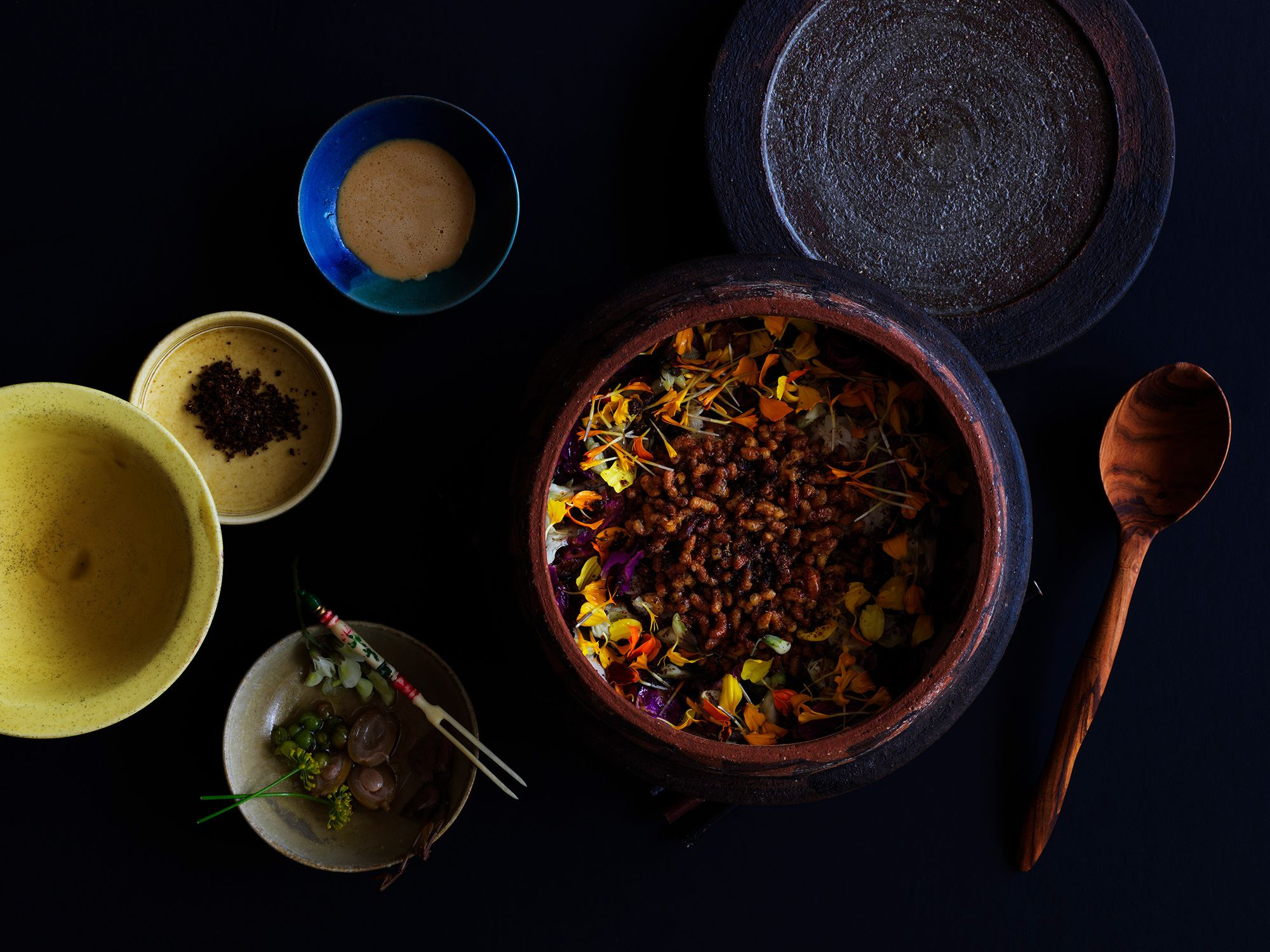Many of the customers express the bee larvae claypot rice dish as their most impressive dish at INUA. Photography Jason Loucas