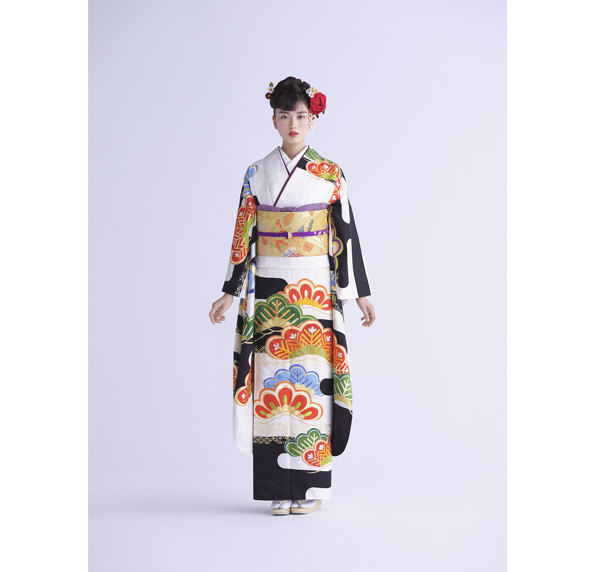 The combination of the fukuro-obi (double-layered sash)'s gold and tabane-noshi (bundled noshi) raises the joy of celebration.